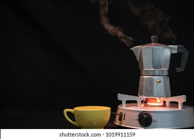Metal coffee percolator with coffee cup prepare hot coffee