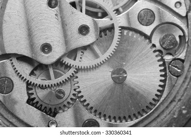 Metal Cogwheels inside Clockwork. Concept Eternity, Teamwork , Idea Technology. Black and white Macro Photo.