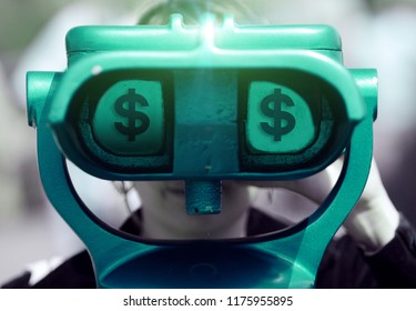 Metal coin-operated public binocular with money dollar symbol