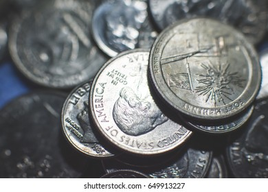 Metal coins background. American dollar and cent.