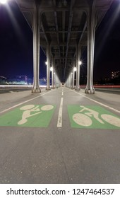 Metal columns and abutments of ''Bir Hakeim'' bridge. People walks and make jogging under the bridge in Paris.The bridge is one of the most famous and historic landmark