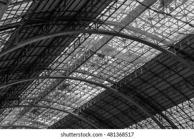 Metal construction abstract background. Structure of steel roof frame for construction in black and white.