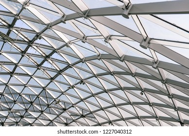Metal construction. Abstract object with windows resembling a rhombus. Glass dome