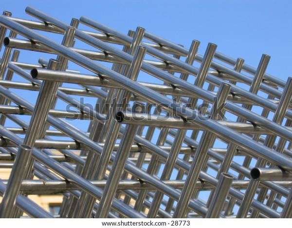 Metal construction against blue sky.