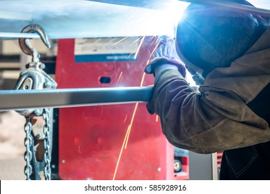 Metal construction worker with blurred motion working on a steel construction