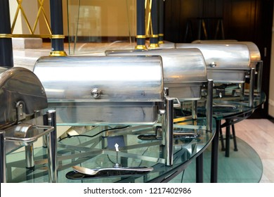 Metal containers with hot food in the restaurant. Self-service