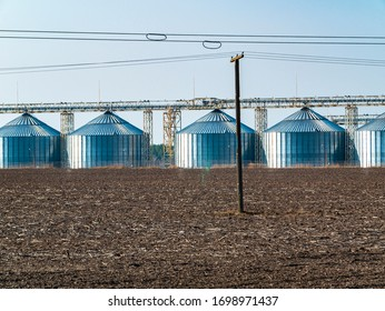 Metal containers for storage elevator on the horizon. Industry. Place for text. Background image.