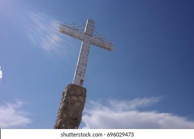 Metal cross against blue sky
