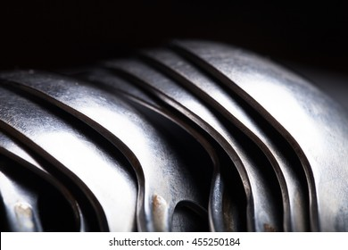 Lot of metal cutlery on a black background. Selective focus. Shallow depth of field.
