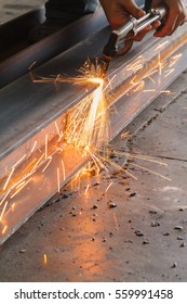 Metal cutter, steel cutting with acetylene torch, industrial worker on manufacturing area.