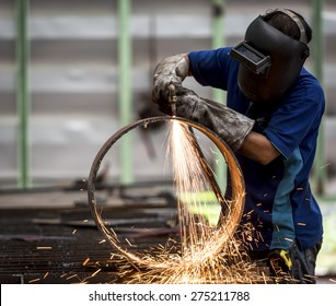 metal cutting with acetylene torch (Focus on Torch)