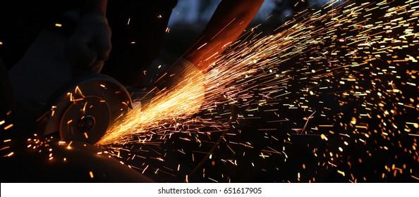 Metal cutting. Metal cutting with angle grinder.Man cuts metal