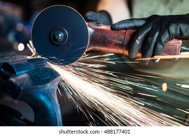 Metal Cutting Tool in Action. Closeup Photo. Construction Theme.