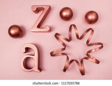 Metal decorative objects on pink background. Copper, rose gold color.