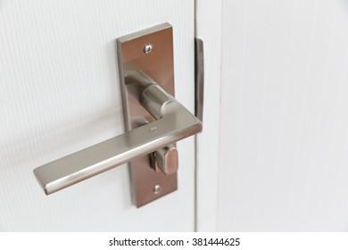 Metal door handle.
