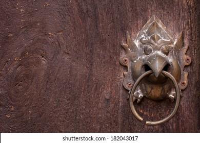 metal door knocker, Asia Thai style metal garuda door knocker on wooden door