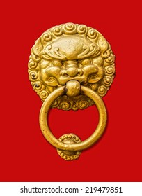 Metal door knocker in Chinese design for interior and exterior isolated on red background