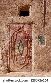 A metal door offers security to a house in the old Mellah district of Marrakesh in Morocco.