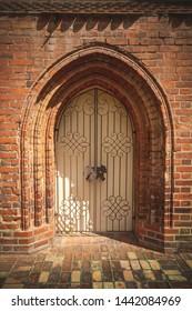 Metal door in old grunge brick wall