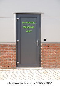 metal door with text authorized personnel only and access control system
