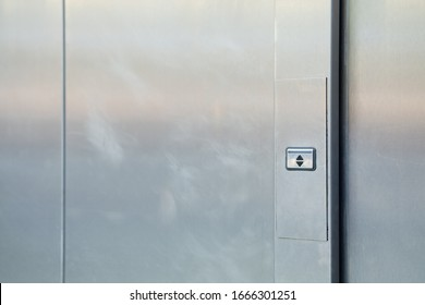 Metal doors with a button up and down. Close up.