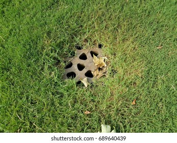 metal drain in the grass