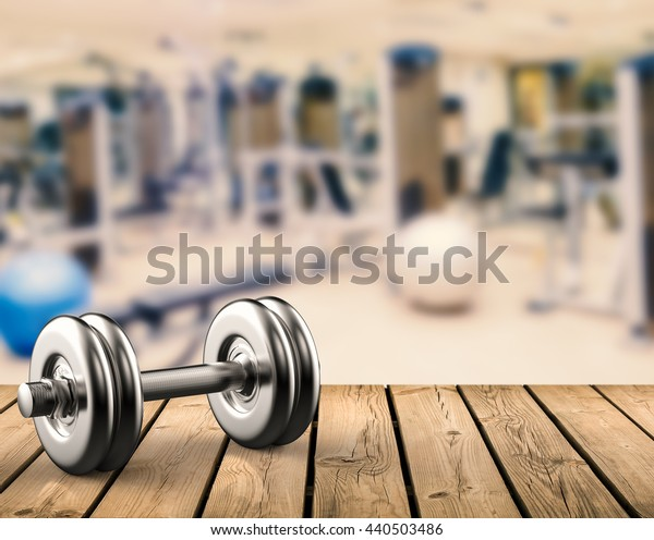 metal dumbbell with gym background