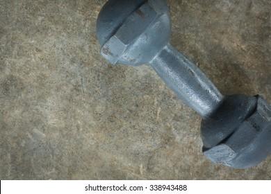 metal dumbbell on cement floor, fitness sport of bodybuilding background