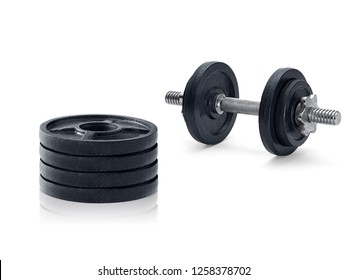 The metal dumbbell and weights isolated on white background