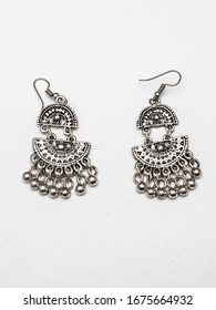 Metal earrings on a white background