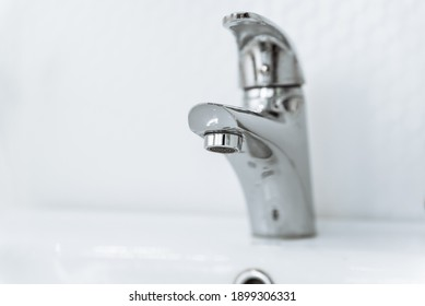 metal faucet in the bathroom without water