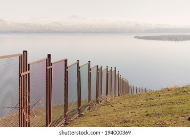 metal fence along river's bank
