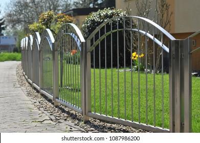 Metal Fence of High-Grade Steel surrounding a House Garden