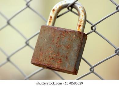 metal fence and rusty padlock