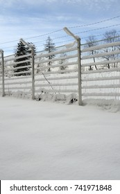 Metal fence and snow landscape, white background, Savoy, France