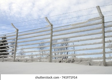 Metal fence and snow, white background, Savoy, France