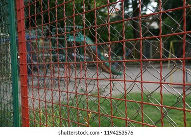 A metal fence surrounding the children playground park