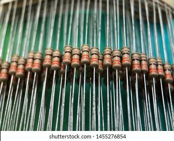 Metal Film Resistor on Cool Blur Background.  Carbon Film Resistors.