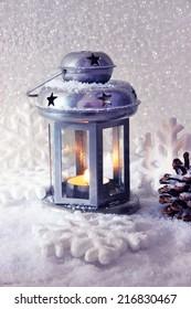Metal flash light and Christmas decoration on light background