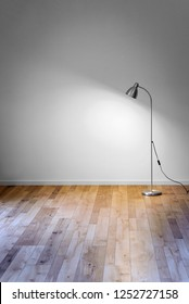 metal floor lamp in empty room with shadow on white wall and copy space for text