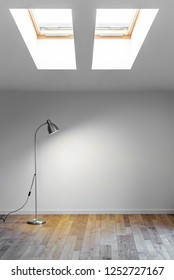 metal floor lamp in empty room with shadow on white wall and two dormer. Copy space for text