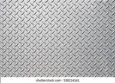 Metal floor plate with diamond pattern.