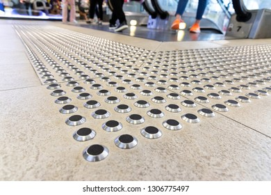 Metal floor tactile to guide vision impaired person at shopping mall in Hong Kong