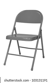 Metal folding chair isolated over a white background