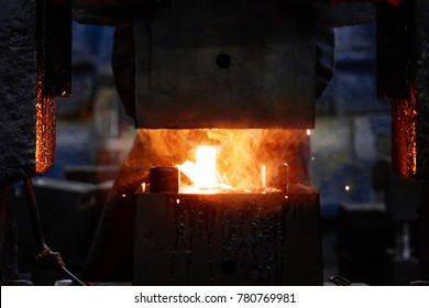 metal forging, forging shop. hydraulic hammer shapes the red-hot billet. the production of high-tech parts