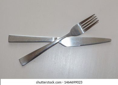 Metal fork and knife on a table