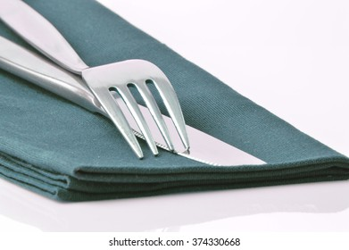 Metal fork and knife on white background