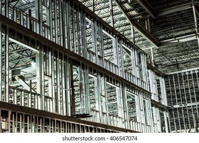 metal frame of building under construction lit at night