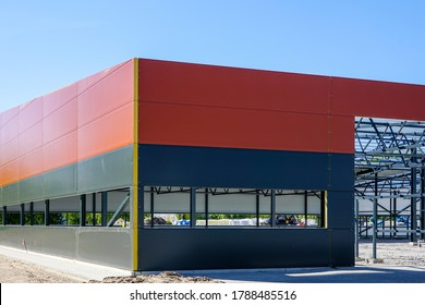Metal frame of the new modern building with a sandwich panel of insulation on the wall