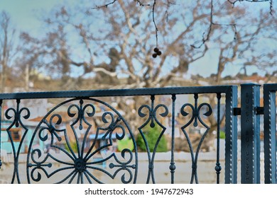 Metal frame and railing in Golyazi, turkey with old town blurred background. Black frame and wooden table.